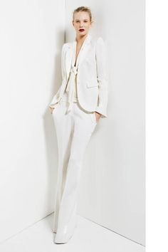 I think every woman should own a white suit.  The color itself is classy and fresh.