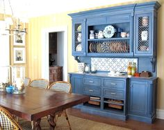 Love the blue china hutch!