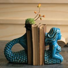 Ceramic Mermaid Bookends made by Charming Accessories For Any Space.