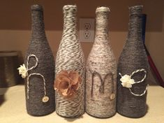 Wine bottles decorated with yarn.
