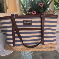 Dana Buchman canvas shoulder bag w/ straw detail A crisp look! Stripes are offset with straw and faux leather. Magnetic closure. Fun neutral interior. Center large zip compartment and ones for phone and keys. Dana Buchman Bags Shoulder Bags