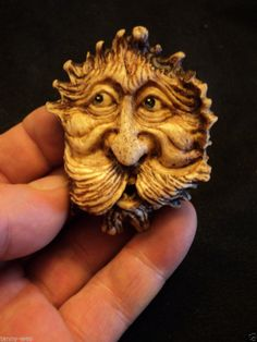 This is a new carving of a wood spirit carved into a moose antler rosette.
