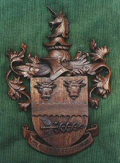 Coat of Arms and Crests, How they are carved from Wood, and also cast in Bronze.