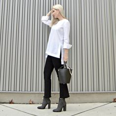 elegant rocker chic over 50, studded boots, Alexander Wang Roxy Bucket Bag Review, modern style, edgy style, edgy details, classic white shirt, cropped flare pants, city style, urban style, style over 40, black and white, modern basics, classic white shirt, classics with a twist