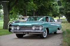 1959 Oldsmobile - Dad had a 4 dr hardtop this color. Loved the color changing speedometer.  Funny, when buried it flashed on and off red to white!