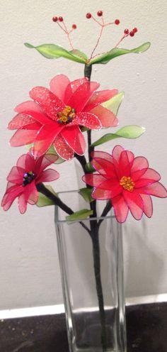 Red nylon flower arrangement with vase