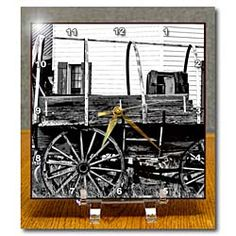 An old wagon with wooden wheels near a home in Southern Utah Desk Clock