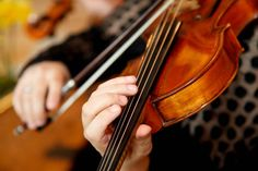 Up close violinist --- a new image we're using courtesy of photographer Aimee Grindon.