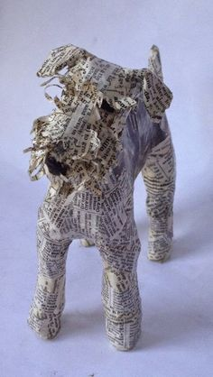Artist identifies as Schnauzer, but could easily be an Airedale!  Atelier Making Art DMC: The LORRAINE OF CANINE WORLD CORRIGAN - ART paper mache.