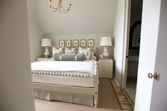 Sloped roof line, grey, soft bedroom, painting picture collection, painted bed, goard lamp, brass