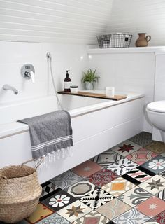 When it comes to cement tile trends, patchwork is where it's at. Colorful and exuberant, patchwork's riotous mix works just as well in traditional homes as it does in spare, modern ones. This collage of pattern and color doesn't need a large space for a big effect so if you're unsure start with small doses and use them in the shower or tub surround.