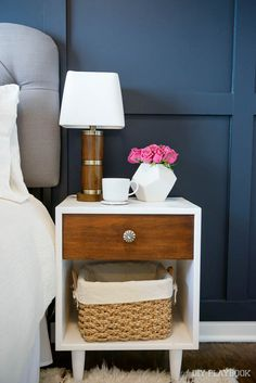Add a basket from HomeGoods to your nightstand to keep books and magazines at reach, but out of sight! Love this organized bedside look (Sponsored Pin)
