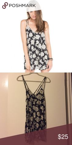 Brandy Melville Selda Dress Black and white floral print dress. One-size-fits-all. Double straps tank top style. Incredibly cute. Brandy Melville Dresses Mini