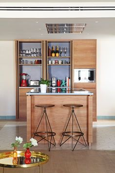 Material mix: tray HABIBI by Philipp Mainzer specified in apartment with wooden open-plan kitchen. / www.e15.com #e15 #brass