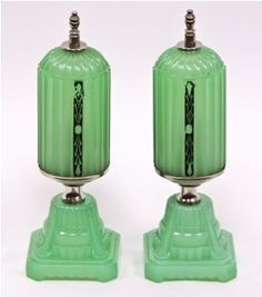 "exceptional pair of c. art deco style boudoir or ""bullet"" table or vanity lamps. the unique and very desirable jadeite green glass deco boudoir lamps are fluted with recessed deco motifs highlighted in the original baked enameled black finish. Antique Lamps, Vintage Lamps, Vintage Lighting, Vintage Glassware, Boudoir, Chandeliers, Art Nouveau, Lampe Art Deco, Love Vintage"