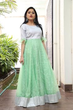 Beautiful seagreen color floor length dress with bell sleeves. Floor length dress with floral print. Price : 5000 to 6000 INR. To order whatsapp Long Gown Dress, Frock Dress, Long Frock, Long Gowns, Indian Gowns Dresses, Indian Fashion Dresses, Long Gown Design, Frock Models, Kalamkari Dresses