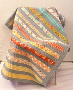 Modern Handmade Baby or Toddler Quilt in Orange, Blue, Green, Yellow & Aqua.