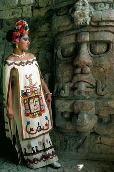Young woman in mayan dress posing by statue of sun god at mayan ruins of kohunlich yucatan mexico indian feather decoration accessories maxi love bohemiastyle shopping clothing stylish fashion design boho amazing Mexican Fashion, Mexican Style, Mexican Folk Art, Mexican Artwork, Mexican Heritage, Inka, Style Ethnique, Aztec Art, Beauty And Fashion