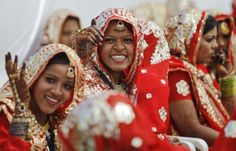 Muslim brides smile as they wait for the start of their rituals during a mass marriage ceremony in the western Indian city of Ahmedabad March 3, 2013.