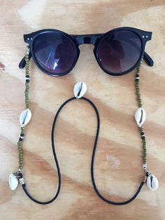 Phase accessories: Sunnycords boho cowry shells olive green Diy Glasses, Glasses Frames, Trending Sunglasses, Round Sunglasses, Beaded Jewelry Designs, Eyeglass Holder, Bijoux Diy, Shell Necklaces, Cute Jewelry