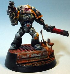 The Loyalist Red Scorpions Chapter of Space Marines is known to be composed of conservative Imperial purists who are famed for their complete and utter devotion to Imperial doctrine, past the point where pragmatism or even reason would seem to require otherwise. The Chapter is most renowned among other Astartes for their absolute adherence to every line of the Codex Astartes