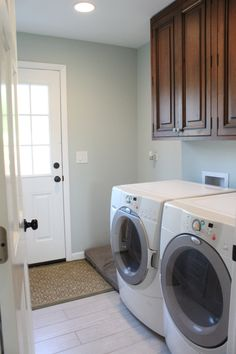 Paint the walls Sea Salt by Sherwin Williams, same as main level. Hang cabinet over the washer/dryer.