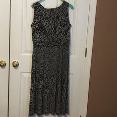 Black with white polka dots dress Worn once. Bodice is lined. Has lovely ruffled waistline. Very flattering- just too small for me now  has been dry cleaned and ready to wear. Dress Barn Dresses Midi
