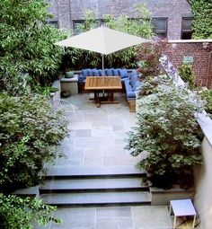 An urban garden blossoms from a confined space into an entertaining oasis. Judy Kameon of Elysian Landscapes incorporated natural bamboo screens with a built-in banquette to create a serene patio that exists worlds above the New York City pavement.ON REMODELISTA: A Blooming Brownstone