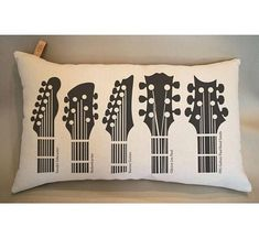 Guitar Headstock Pillow Fender Telecaster Rickenbacker Ibanez Guitars Gibson Les Paul PRS Guitars Paul Reed Smith  Original Copyrighted Artwork Illustration of the Guitar  12x20 100% Cotton Canvas Screen Printed Guitar Pillow Heavy Canvas just perfect to touch, fun to play with. Must for a Guitar Player Go with Music original artwork inspired by Guitar Headstock Handmade item by us. Complete Pillow with Insert, ready for the concert performance.