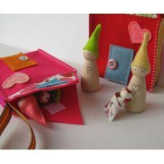 Houses for peg dolls - from Etsy shop. Oh, goodness this is cute. I love the swaddled baby doll!
