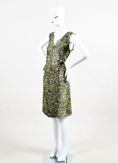 Sleeveless silk dress is printed with abstract designs. V-neck. Pulls on. Size: 42 Made in: Italy Color: Black, Green, Yellow Fabric Content: Silk Condition: Pre-owned. This item is in good condition.