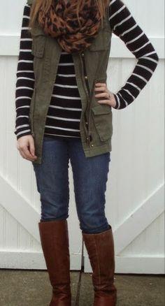 Cargo vest, striped tee, leopard scarf.