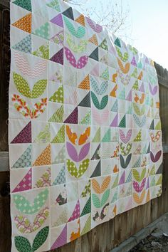 looooove this quilt using Heather Bailey's True Colors and Lottie Da lines… the petals are beautiful!
