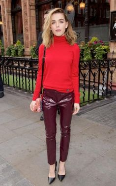 Mad Men star Kiernan Shipka stamped her fashion prowess at the Lady Dior pre-show party in high-shine burgundy trousers on May 30, 2016