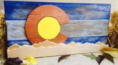 Rustic Colorado Flag with Rocky Mountains