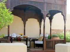 Check out this amazing Moroccan-style pergola for an outdoor seating area.