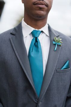 Like the idea of the gray tux with brightly colored vest and tie
