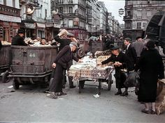 Occupied Paris: Older Parisians visit the garbage in order to find something edible.