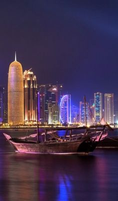 Colorful night skyline of Doha, the capital city of Qatar, located on the coast of the Persian Gulf.