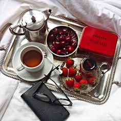 """Fauchon Tea """"les 4 fruits rouges"""" black tea with red fruits flavors/ Strawberries/ Cherries / Hediard fruits"""" fine jam/ Hediard Almond biscuits box/ Ray-Ban """"wayfarer"""" eyewear/ Louis Vuitton pocket diary in epi leather/ silver teapot/ silver tray Cherries, Strawberries, Pocket Diary, Silver Teapot, Breakfast Tray, Silver Trays, Red Fruit, Chai, Whisper"""