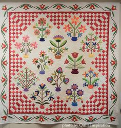Blossoms and Butterflies by Kristen White Webb. 2015 Springville (Utah) Quilt Show.  Photo by Quilt Inspiration.  Update: This is the Flourishes quilt pattern by Piece O' Cake Designs.