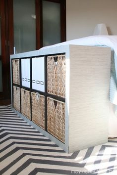Expedit Storage at the Foot of the Bed (perfect for extra storage in the master bedroom ... replace with a bench if storage isn't needed)