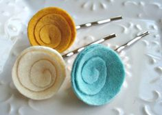 swirly felt hair pins.