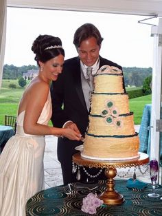 Gorgeous #brideandgroom & Groom cutting their wedding cake! Gold Chandelier #cakestand by Opulent Treasures   Tiered #Weddingcake by Pearl's Cupcake Shoppe   Charlottesville, VA