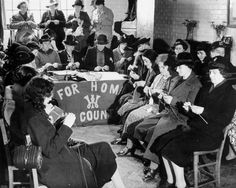 Women knitting as part of the WWII war effort, 18 November 1939. Knitting Bee at the Great Kingsmill Village Hall, near High Wycombe in Buckinghamshire ~