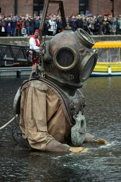 A giant deep sea diver, the uncle of the little giant girl, makes it's way through the streets of Liverpool as the Titanic Sea Odyssey giant puppet spectacular gets underway on April 20, 2012 in Liverpool, England. Over the next 3 days French street theatre company Royal De Luxe will be performing Sea Odyssey with the giants coming to life telling a story inspired by The Titanic. (Photo by Christopher Furlong/Getty Images)