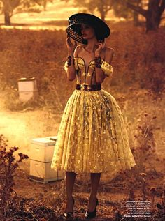 Alexandaer McQueen's innovative Bee Keeper hat is featured on Cassi Van Den Dungen for Vogue Australia March 2013.
