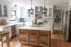 Modern Farmhouse Kitchen Makeover Kitchen remodel with white cabinets, lantern lighting, wood Island, and a gray subway tile backsplash. Country Kitchen Farmhouse, Modern Farmhouse Kitchens, Cool Kitchens, White Farmhouse, Farmhouse Decor, Colonial Kitchen, Farmhouse Sinks, Kitchen Rustic, Kitchen Modern