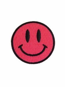 PINK SMILEY FACE SEW ON PATCH. Hand & Lock have developed a range of fashion patches. In the blink of an eye you can refresh a tired old denim jacket make over a satin bomber or personalise your favourite rucksack.  Our durable machine embroidered pink smiley face patch is made using Madeira rayon threads which can be washed with a mild detergent at 60C.