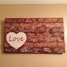 Paint a rustic slab of wood as a guest book alternative!